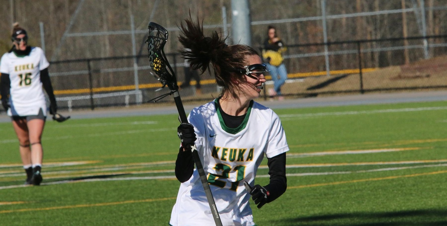 Brenna Voigt (21) tied the school record with 9 goals on Sunday