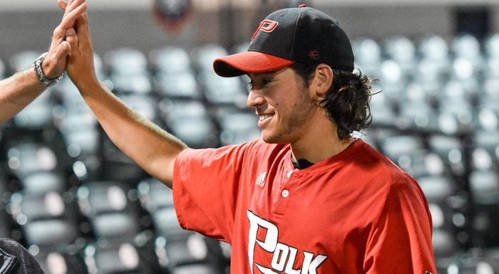 Zach Schneider gets a high five after earning a save in Polk State's 8-4 win over Eastern Florida. (Photo by Tom Hagerty, Polk State.)