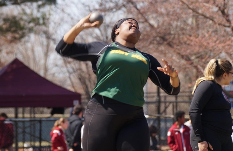 Diana Echols about to release a shot put.