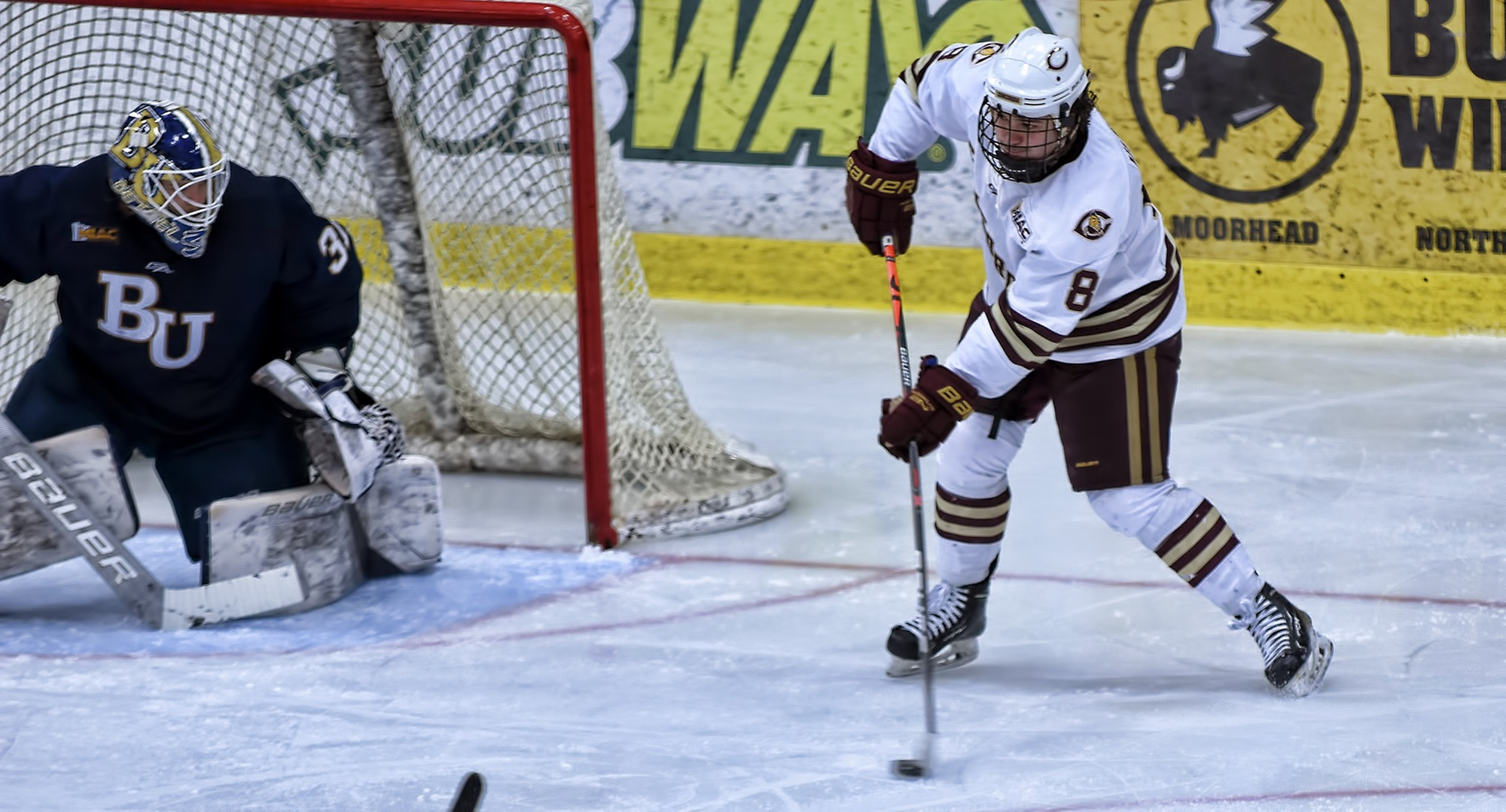 Senior Aaron Herdt makes a centering pass during the first period of the Cobbers' game with Bethel. Herdt scored both game-winning goals in the sweep over the Royals.