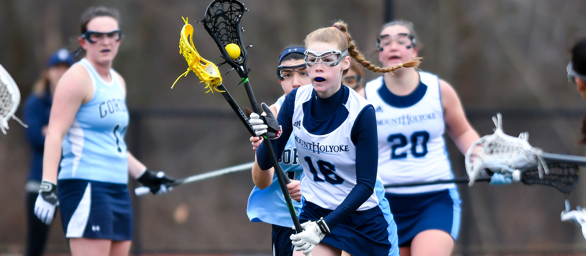 Action photo of Lyons lacrosse player, Haley Subocz.