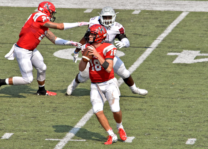 Michael Lambert completed 18-of-29 passes for 336 yards and tied the Huntingdon single-game record with six touchdown passes against Guilford.