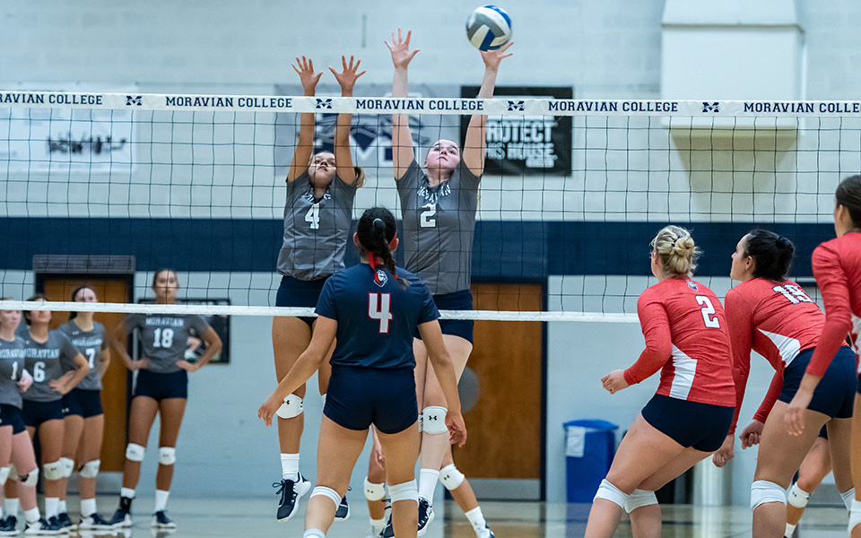 Natalia Matos and Jess Appleton go up on a block attempt versus DeSales University in Johnston Hall.
