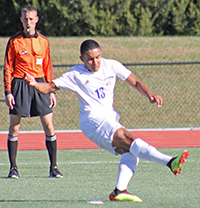 Barton men's soccer player Cyprien N'goma launches penalty kick for 1st collegiate goal