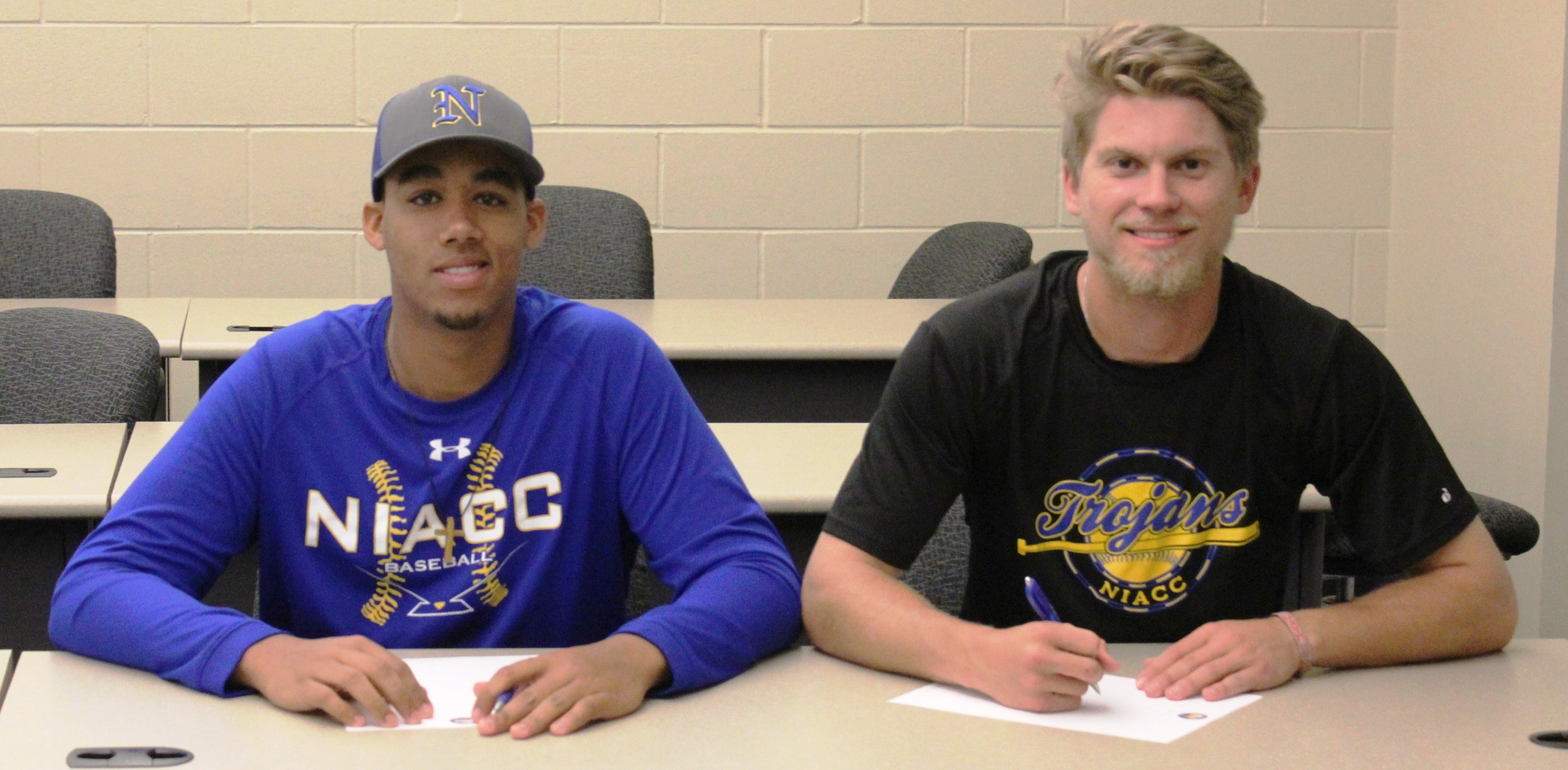 Ryan Huntington (left) signed with Grambling State and Connor Enochs signed with Southern Illinois-Edwardsville.