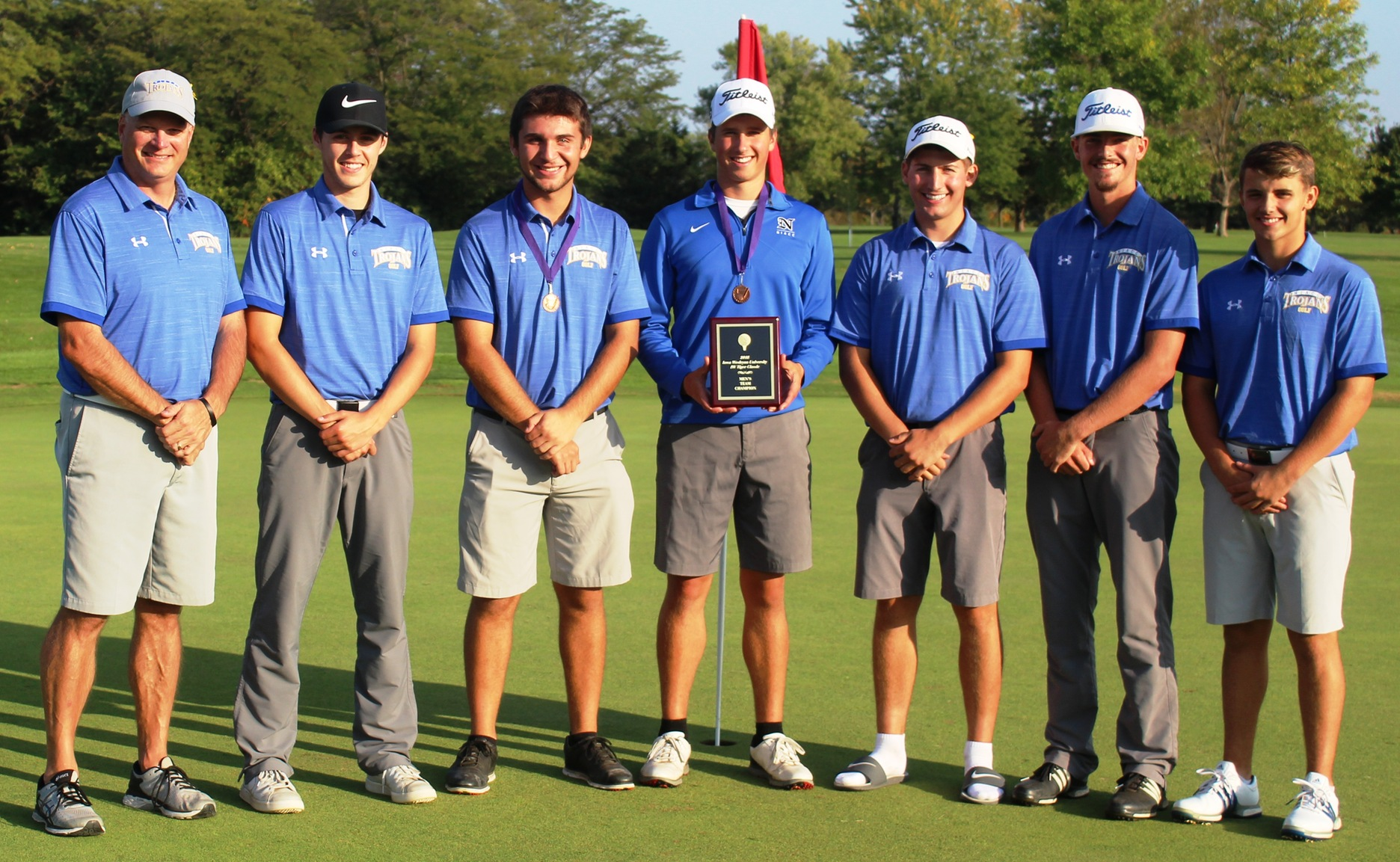 The NIACC men's golf team with its winning plaque at the Iowa Wesleyan Tiger Classic.