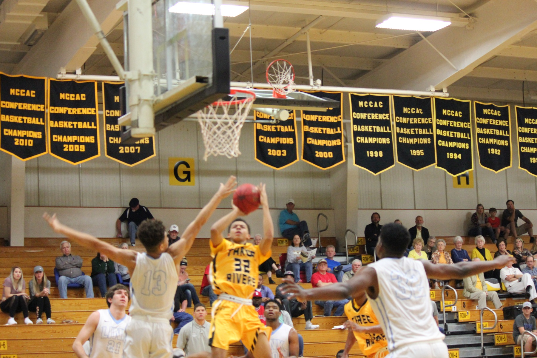Wilson's free throws with 20 seconds left lift Raiders to 1st win