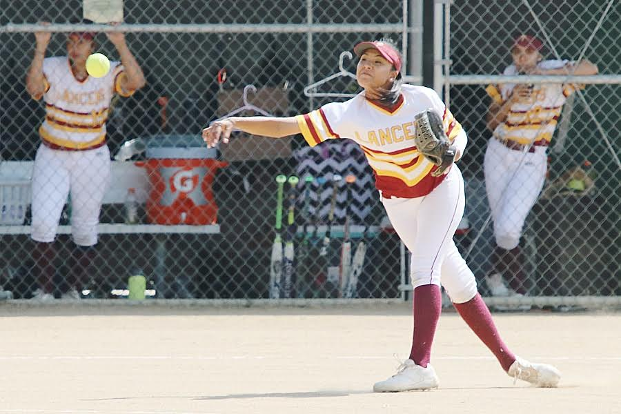 Lancer third baseman Brittany Ching fires a ball to first during PCC's win Thursday at Robinson Park, photo by Richard Quinton.