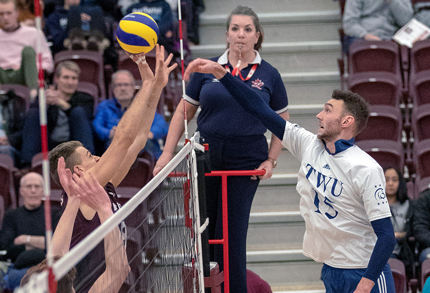 Kai Hesthammer battles Trinity Western's Jacob Kern at the net on Friday night (Eduardo Perez photo).