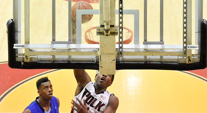 Dayjar Dickson dunks in a 71-59 win over Broward College. (Photo by Tom Hagerty, Polk State.)