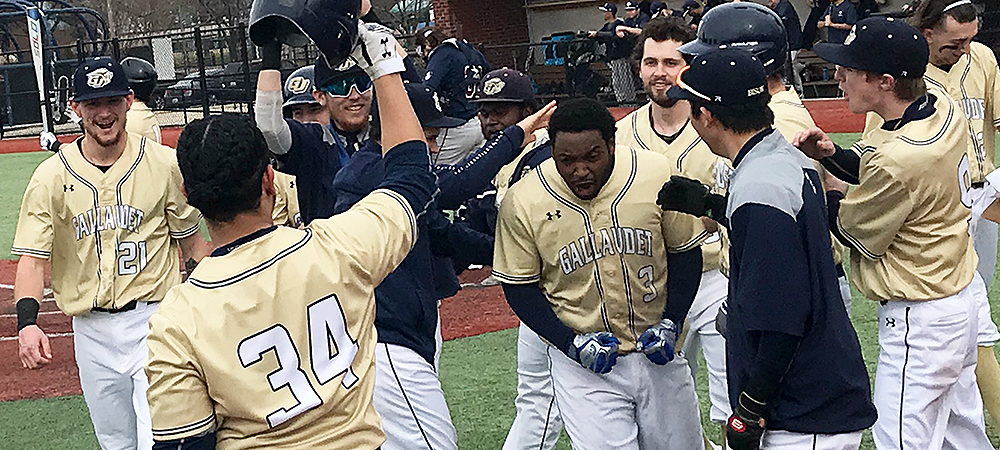 Gallaudet baseball player Winston Lane is really excited and pumped up after he hit a home run. His teammates gather around him after he touched home plate. Go Bison!