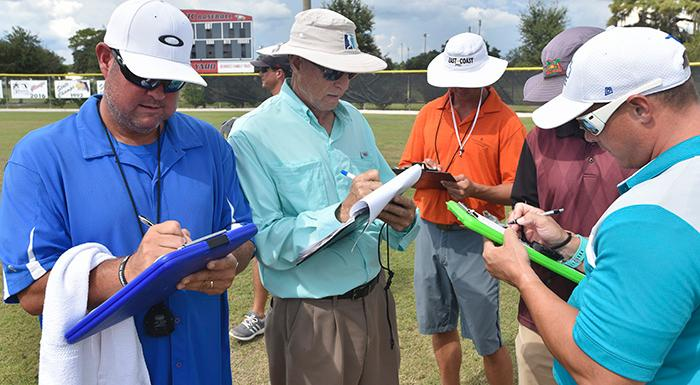 Scouts take notes on Eagles players during Scout Day at Bing Tyus Yard. (Photo by Tom Hagerty, Polk State.)