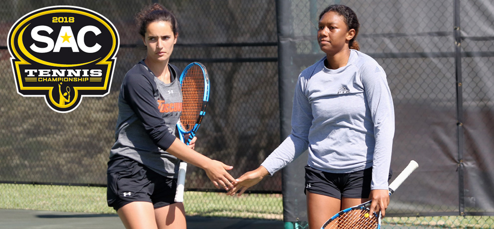 Africa Mota (left) and Amber Lackey won the opening doubles match for the Pioneers (photo by Chuck Williams)