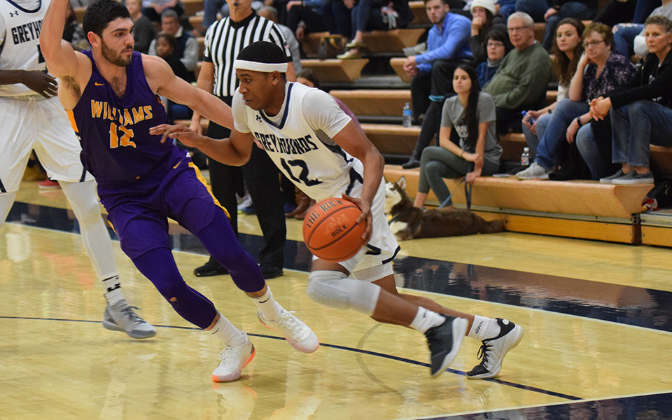 Elijah Davis dribbles down the baseline in a game versus No. 2 Williams (Mass.) College in Johnston Hall in December 2018.