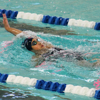 Swimming & Diving Powers Past Simmons