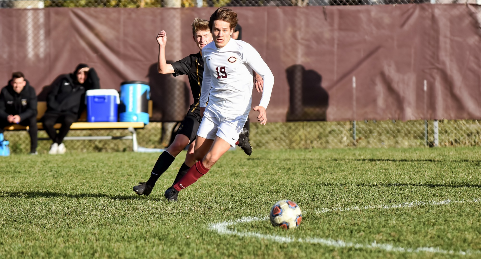 Freshman Sondre Rygg chases the ball in the middle of the field during the second half of the Cobbers' game with Gustavus.