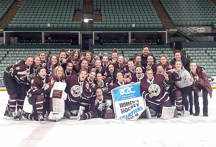 The MacEwan Griffins celebrate with the 2017-18 ACAC women's hockey banner at the Enmax Centrium in Red Deer on Friday night (RDC Athletics photo).