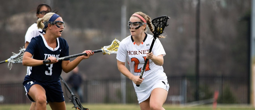 Rachel Madar playing lacrosse.