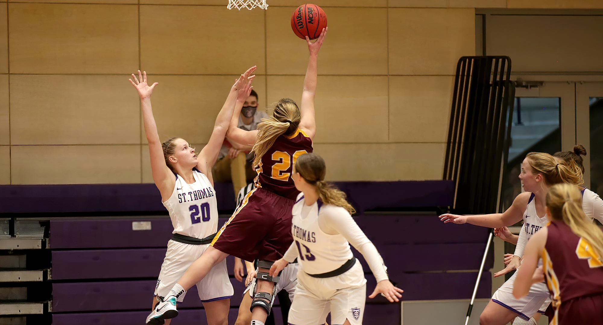 Emily Beseman drives to the basket to drop in two of her game-high 25 points during the Cobbers' game at St. Thomas. (Photo courtesy of D3photography.com)