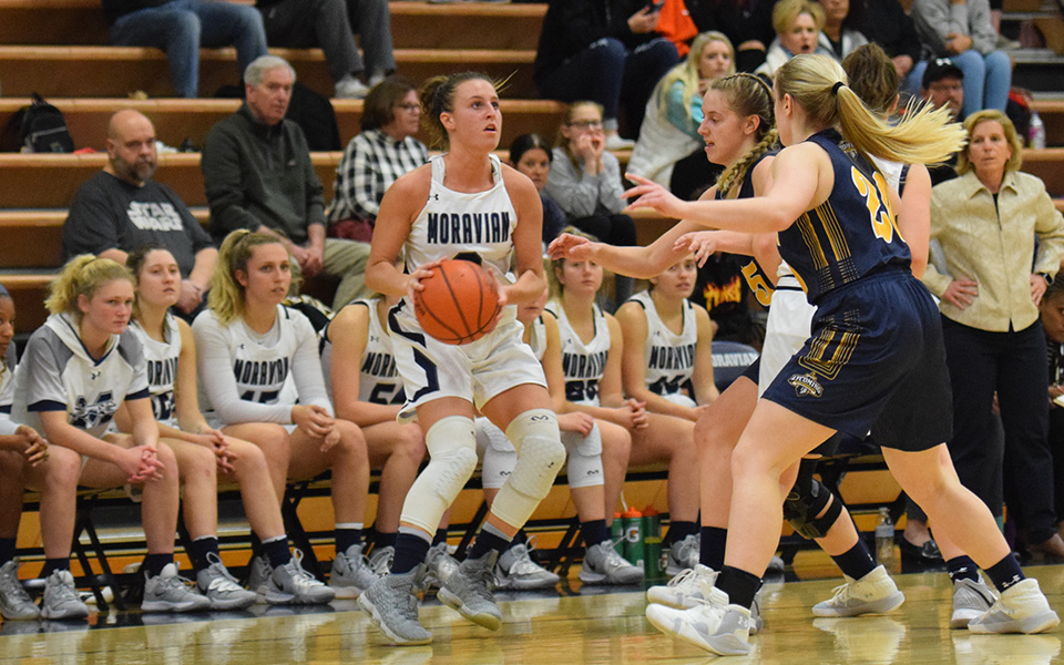 Senior guard Maddie Capuano pulls up to shoot in front of the Moravian bench late in the fourth quarter versus Lycoming College in Johnston Hall.