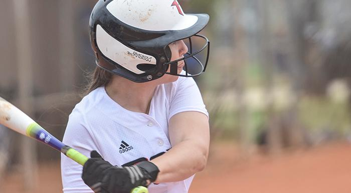 Mikayla Barwig swings at a pitch against Eastern Florida. In two games she had five hits, including a double and a home run, and six RBI. (Photo by Tom Hagerty, Polk State.)