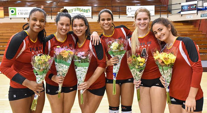 Dayana Teixeira, Elisabeth Piroli, Zoemy Barreto, Suheily Colon, Laina Blanton, and Alejandra Robles pose for a postgame photo on Sophomore Night. (Photo by Tom Hagerty, Polk State.)