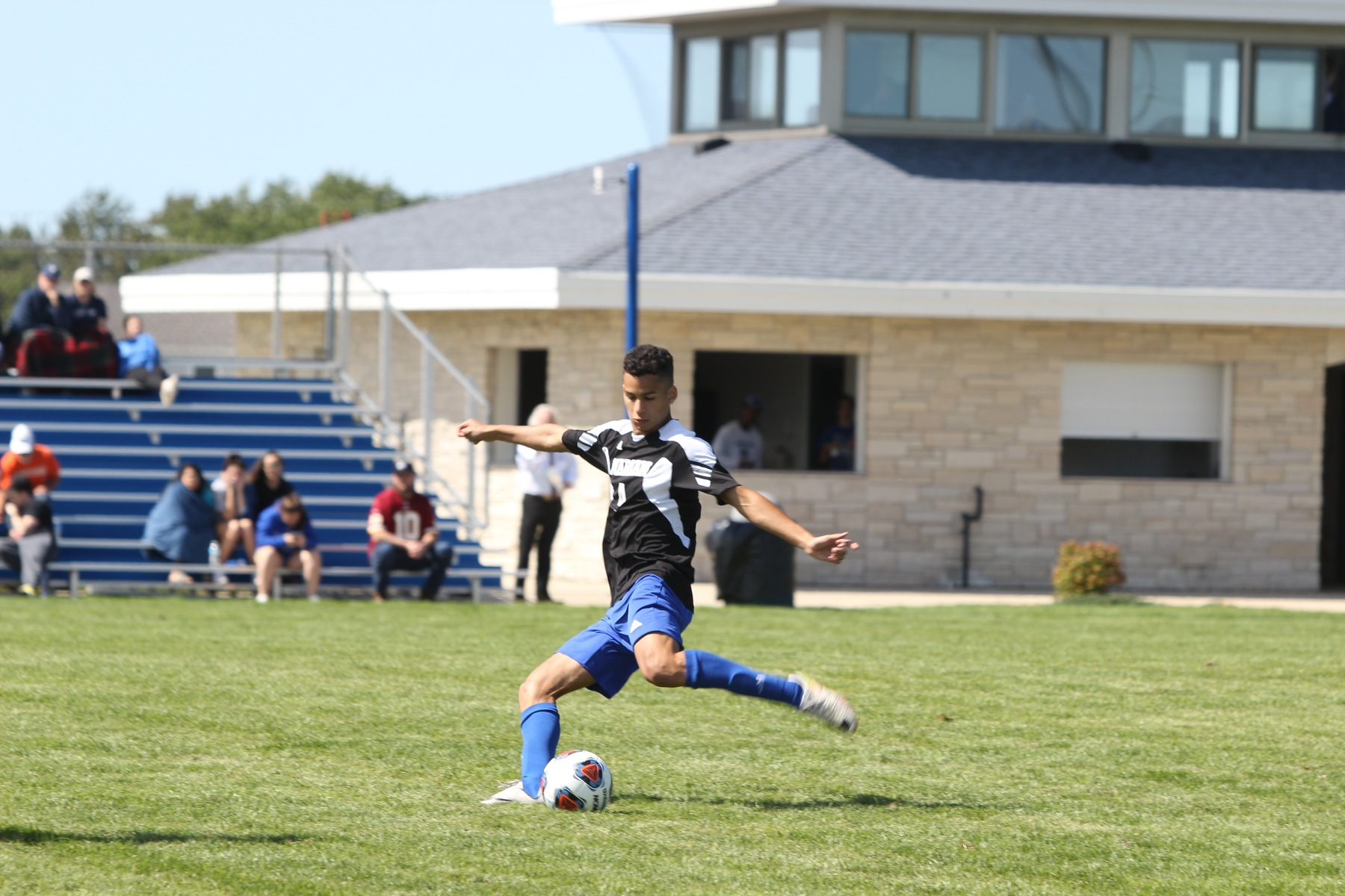 Brandon Mancini kicks the ball.