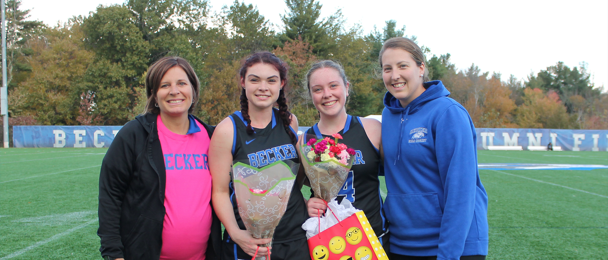 Field hockey seniors with coaches