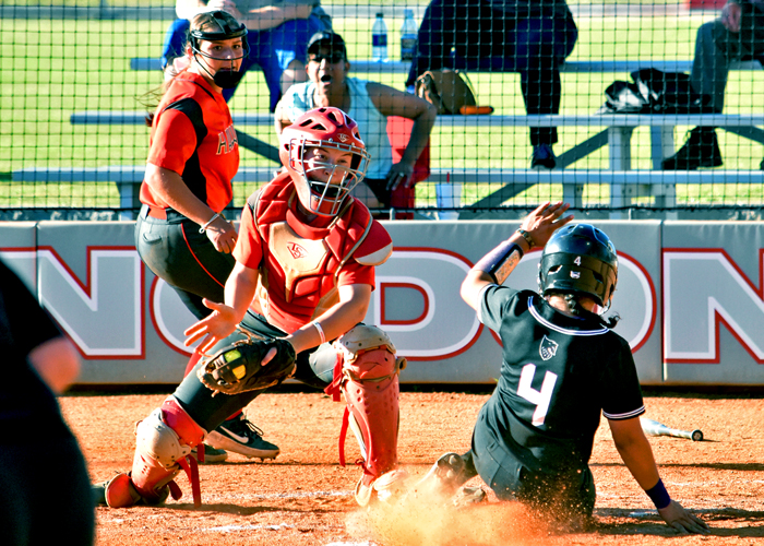 Catcher Kaci Cochran makes a play at the plate to help the Huntingdon softball team preserve a 3-2 lead in Game 1 against Agnes Scott on Wednesday.