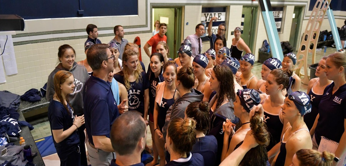 Henry coaching the women's team before a meet.