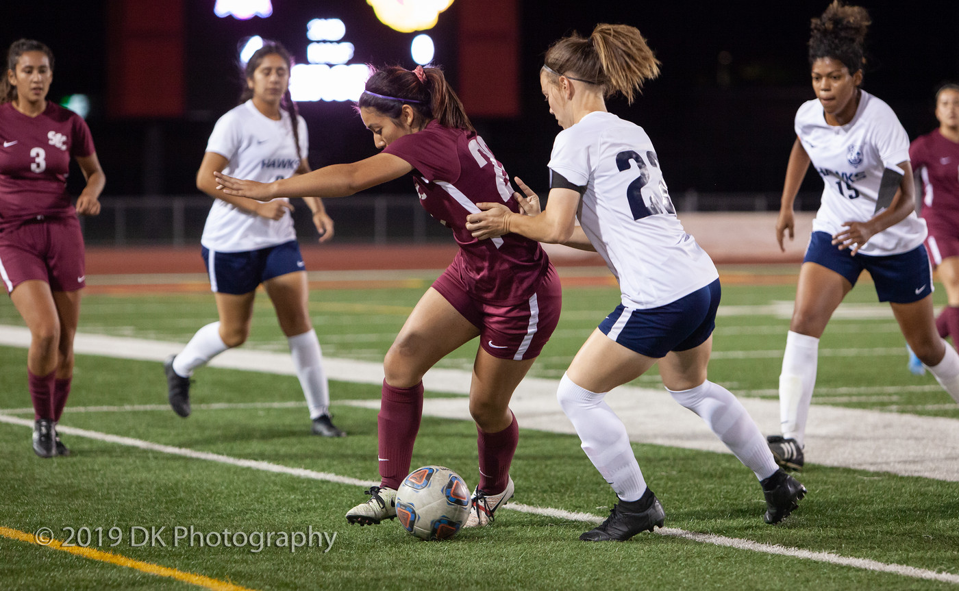 Karina Quintero (#22), City College  freshman fights for the ball in the match against Cosumnes River College at Hughes Stadium on Oct. 3rd.