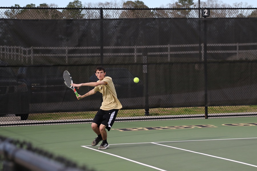 Warrior sophomore Dylan Barnett of Newton County returns a shot against Hinds. (EC Photo)