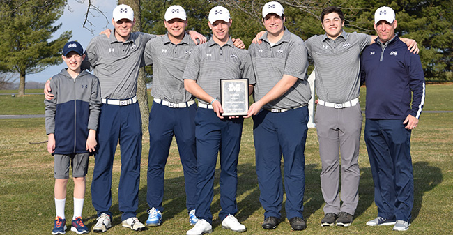 The Greyhounds pose with the first place plaque after winning the Moravian Spring Invitational at Southmoore Golf Course.