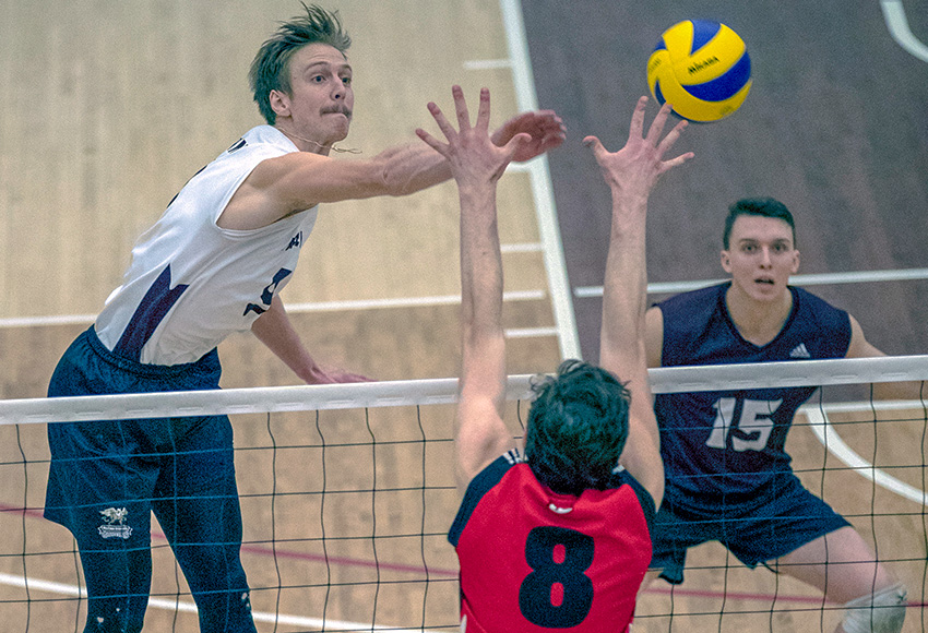 Max Vriend blasts one of his 28 kills on Saturday - a new high watermark in MacEwan's Canada West history (Eduardo Perez photo).