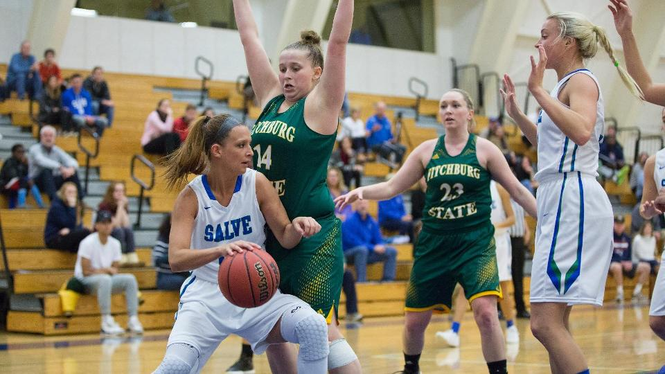 Meaghan Harden (with ball on left) works her way to basket against Fitchburg State. (Photo by Rob McGuinness)