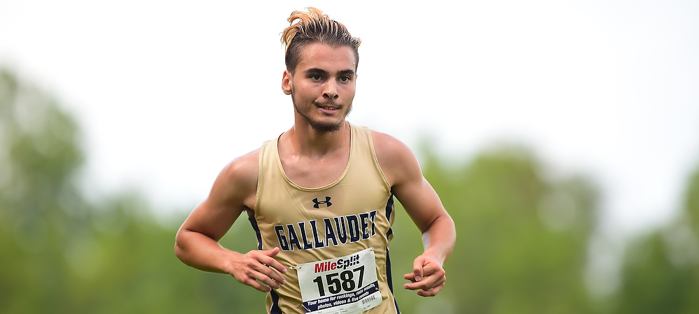 Gallaudet men's cross country runner Jared Spinale runs in the afternoon on a course.