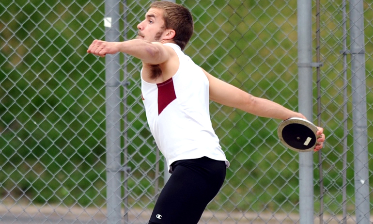 Joe Hendrickson gets ready to fling the discus in the MIAC decathlon. He scored a career-high 5,881 points and finished second. (Photo courtesy of Carleton SID)