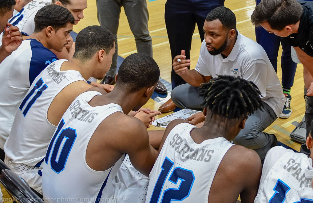 Men's Basketball Huddle with Coach Frazer