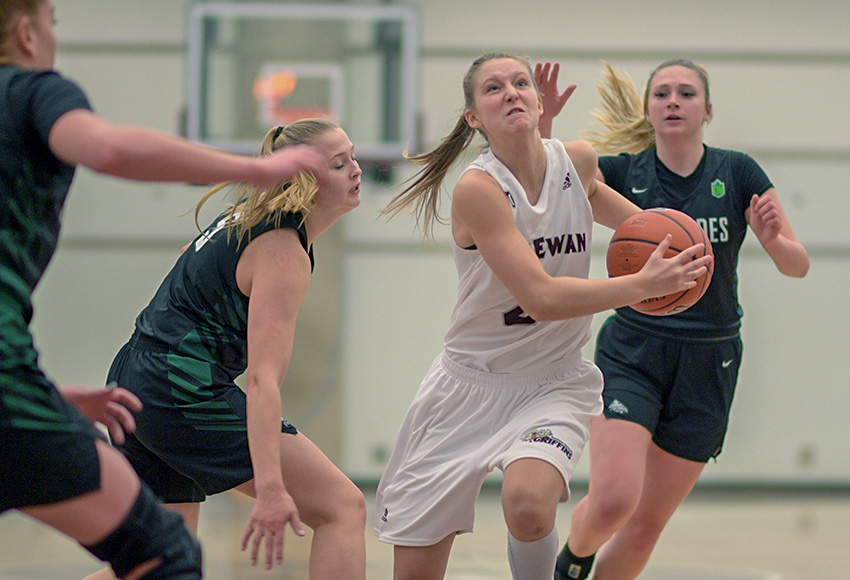With a look of fierce determination on her face, Hannah Gibb charges towards the basket on Friday night (Chris Piggott photo).