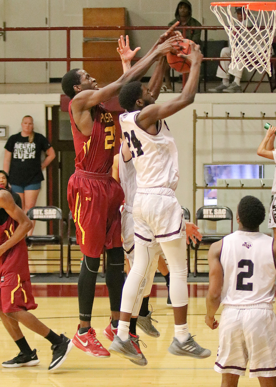 Jordan Simpson reaches for the loose ball offensive rebound at Mt SAC. He had 4 blocks on the defensive side and is one of the state's top shot blockers.
