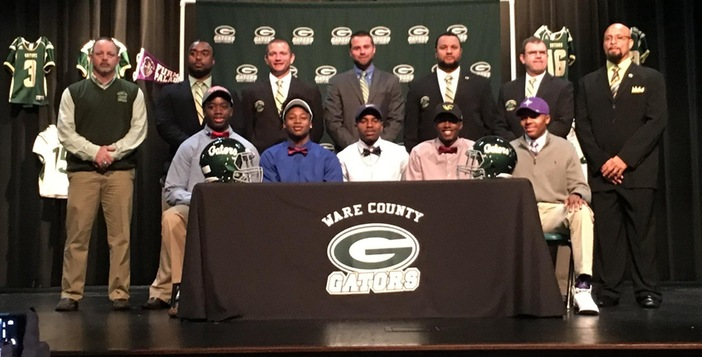 Seven Ware County Football Players Sign College Scholarships