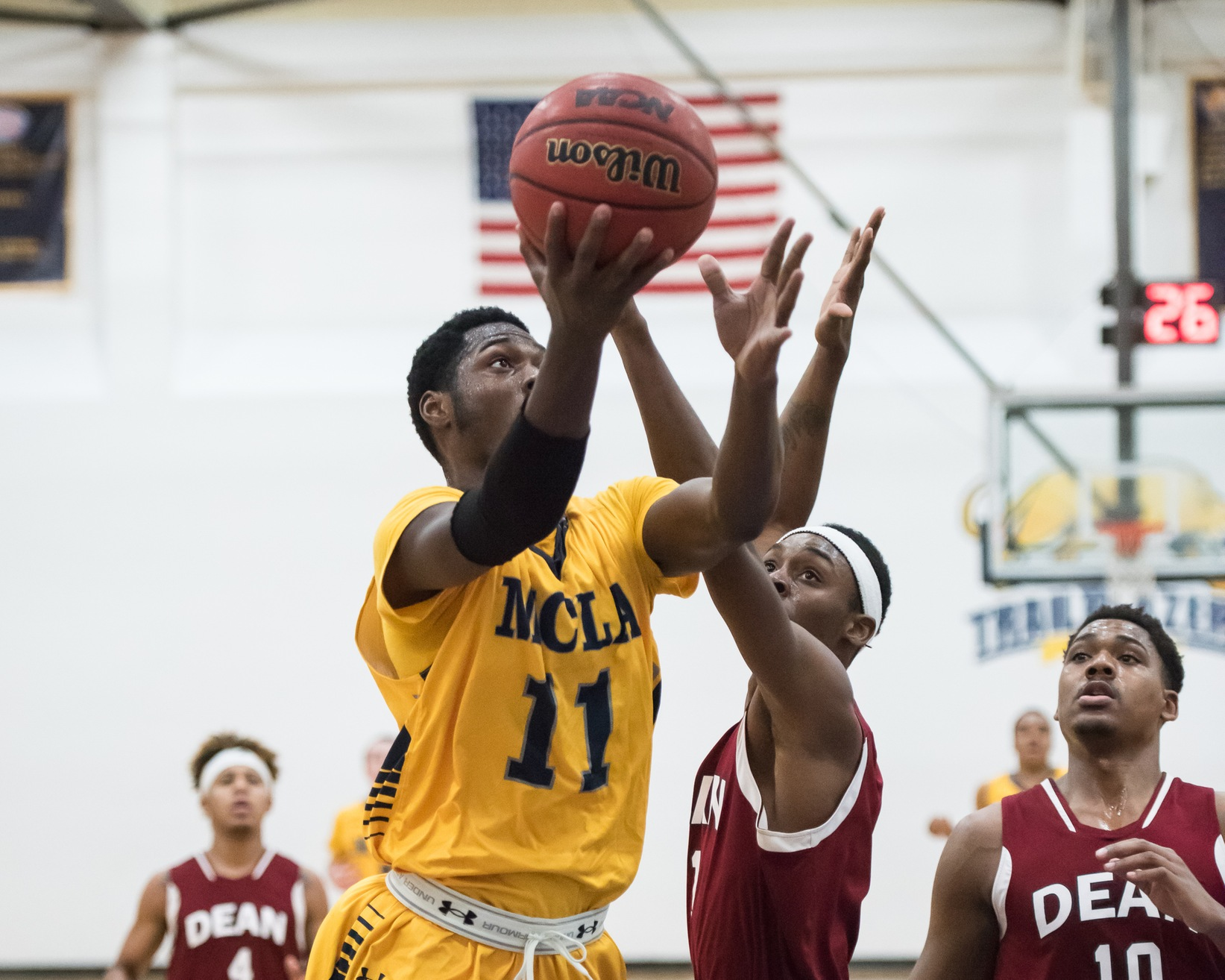 Men's hoop drops high scoring affair to Pine Manor 104-89