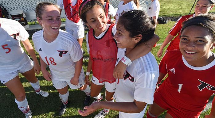 Eagles congratulate Kathryn Huapaya (second from right) after she scored the winning goal in double overtime. (Photo by Tom Hagerty, Polk State.)