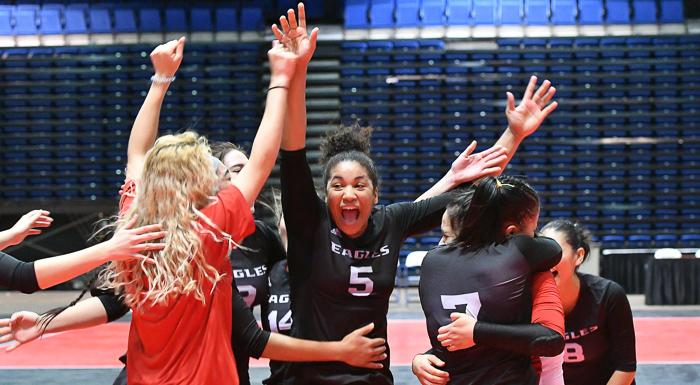 Mariane Cassiano (5) and the Eagles celebrate after qualifying for the national championship tournament and a chance to play for the state tournament. (Photo by Tom Hagerty, Polk State.)