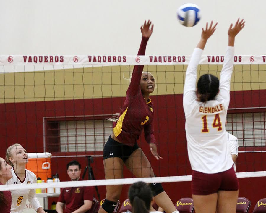 Kendall Schmedes goes up to rip a kill during PCC's sweep at Glendale Friday night, photo by Richard Quinton.