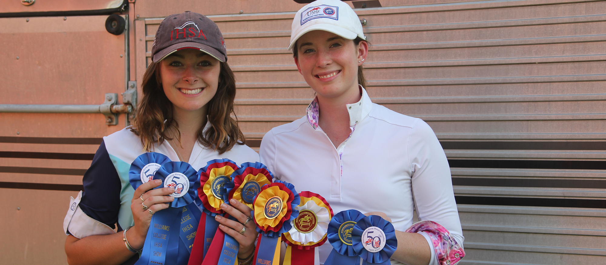 Photo of Lyons riders Sabrina Fox and Anna Rzchowski  displaying their ribbons from MHC's win at the Williams Show on October 14, 2017.