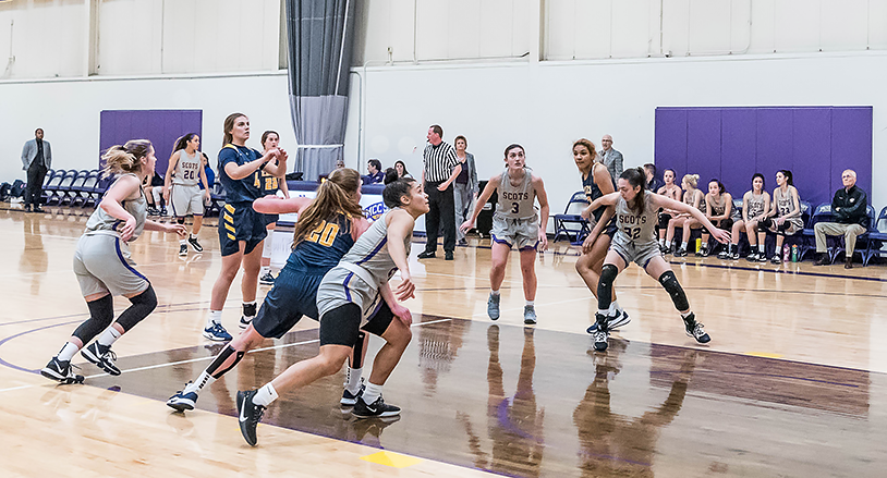 Scots women's basketball players on the court