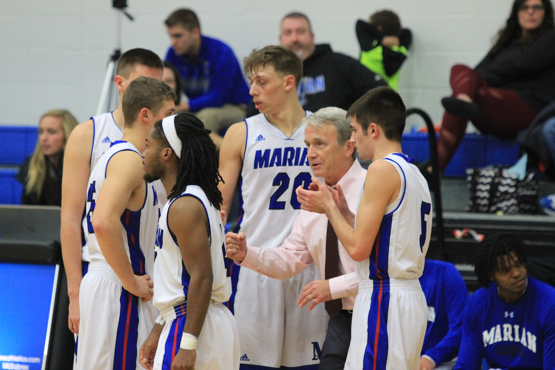 Coach Boyle talks to his players during a timeout.