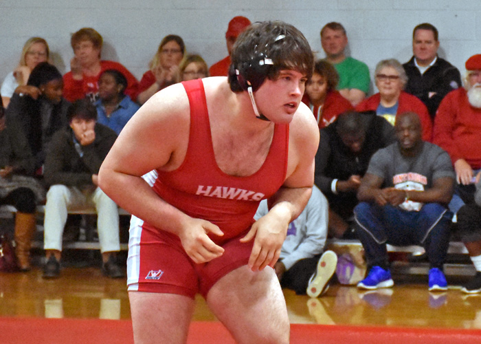 Jesse Rowlen recorded a pin with six seconds left in the 285-pound match to help the Hawks beat Ouachita Baptist 22-21 on Tuesday.