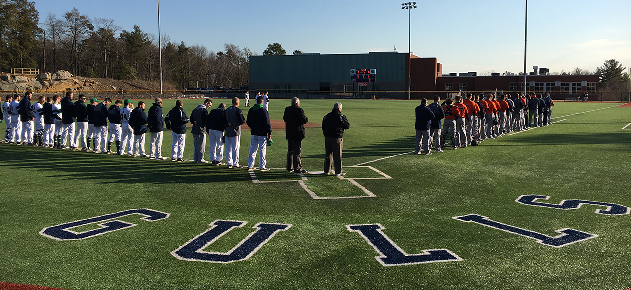 Both the Endicott and Salem State baseball teams take part in the national anthem on North Field.